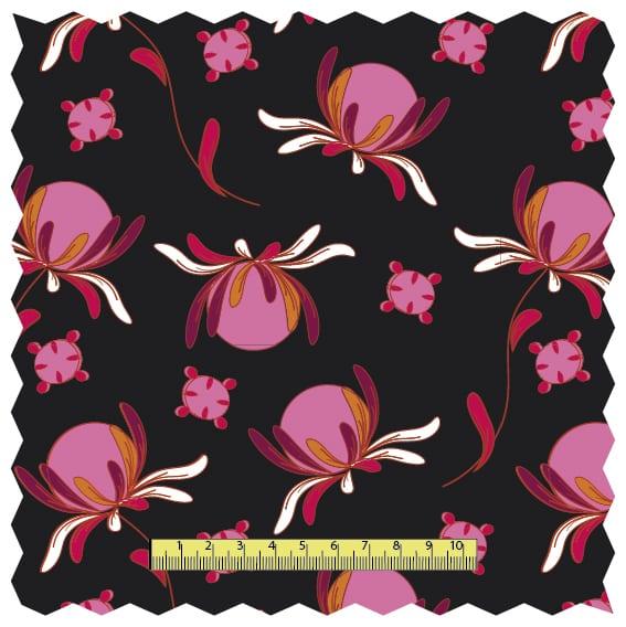 Mönstrad svart trikå med rosa orange detaljer med blommor